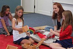 Godly Play teacher with children